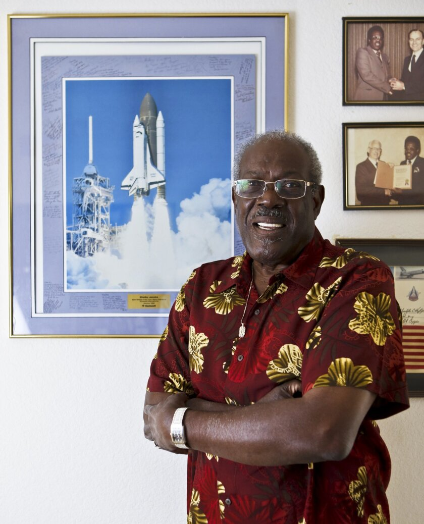 Shelby Jacobs, who turns 80 on April 27, pictured with some of his space program mementos at his Oceanside home.