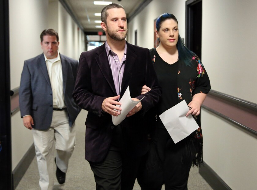 Dustin Diamond enters court in Port Washington, Wis., on Thursday with his girlfriend, Amanda Schutz.