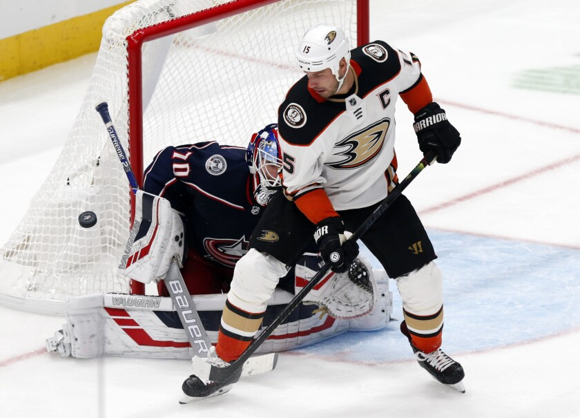 A third-period shot attempt by Ducks forward Ryan Getzlaf is stopped by Blue Jackets goalie Joonas Korpisalo.