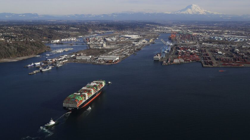 In this March 5, 2019 photo, a cargo ship arrives at the Port of Tacoma, in Tacoma, Wash. U.S. and C