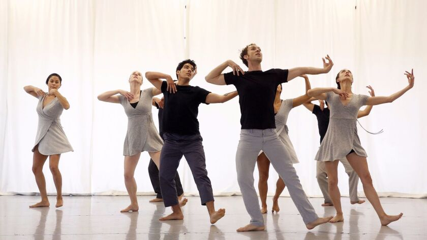 Troupe members rehearse a world-premiere full-company work created by Pablo Francisco Ruvalcaba for Jean Isaacs' San Diego Dance Theater.