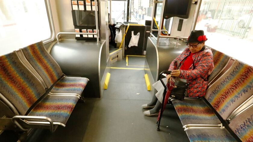 LOS ANGELES, CA - FEBRUARY 10, 2017 - Commuters on the Metro Local Bus in downtown Los Angeles on Fe
