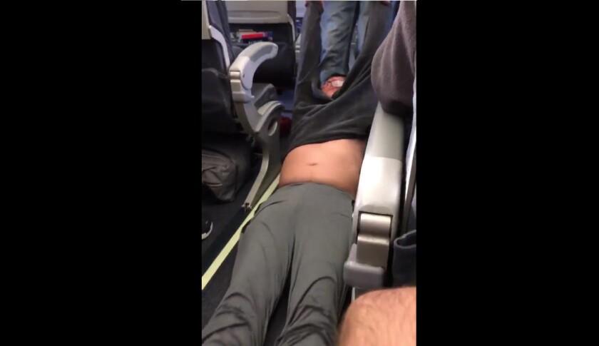United passenger dragged down aisle of plane