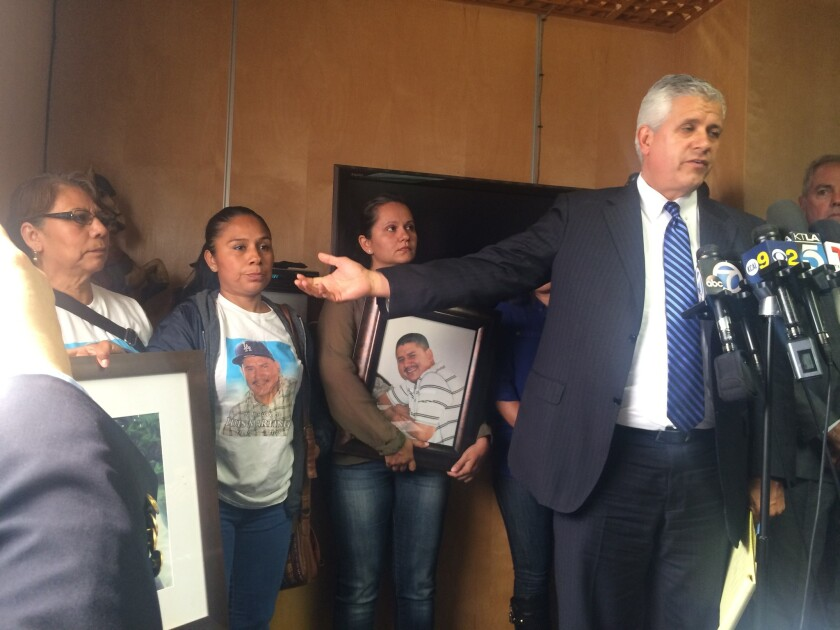Attorney Arnoldo Casillas addresses reporters about the April 2015 fatal shooting of Luis Martinez, 35, by LAPD officers. Casillas is flanked by the wife and other family members of Martinez.