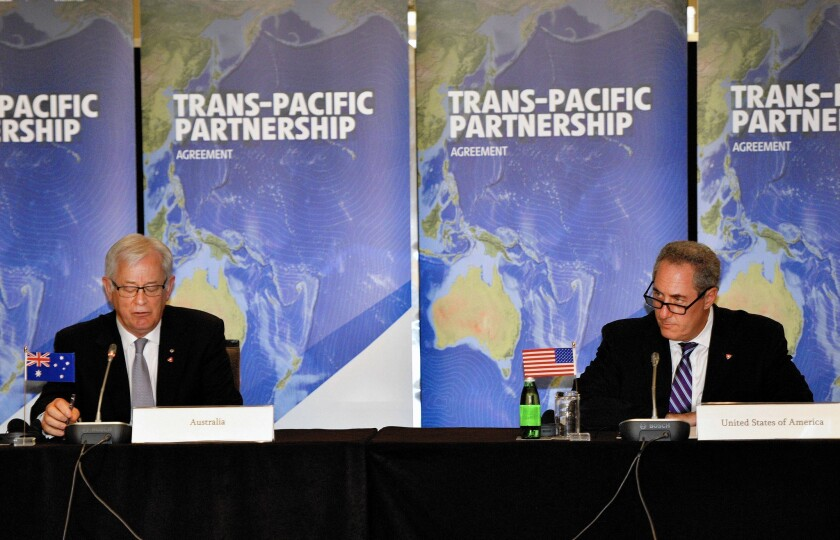 Australian Trade Minister Andrew Robb, left, and U.S. Trade Representative Mike Froman attend Trans-Pacific Partnership talks last October.