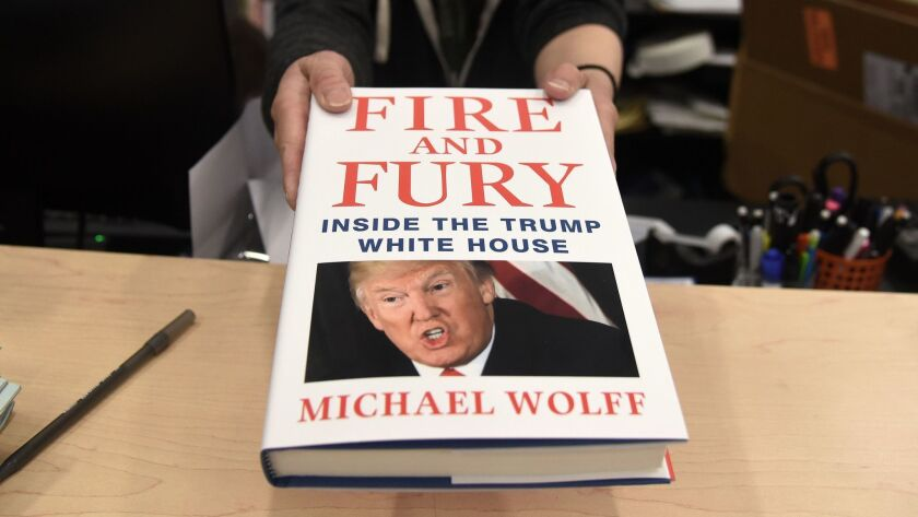 Copies of the book 'Fire and Fury' by author Michael Wolff are displayed on a shelf in Washington D.C.