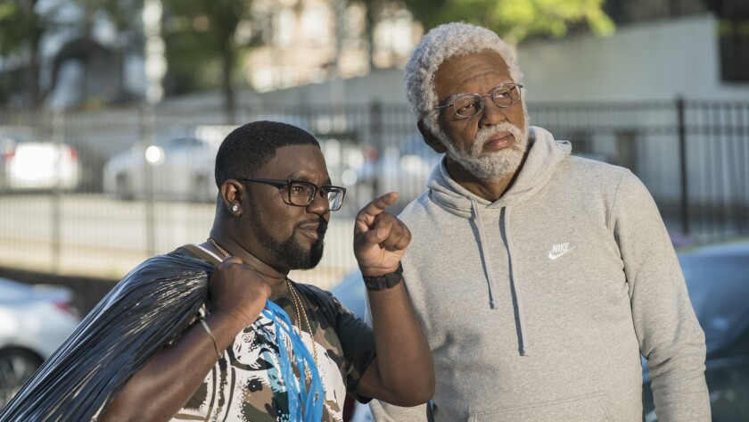 """LilRel Howery as Dax and Kyrie Irving as Uncle Drew in """"Uncle Drew"""" movie."""
