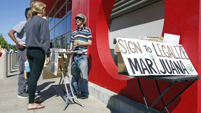A supporter of legal marijuana gathers signatures on what became Proposition 64 outside a store in Sacramento on April 23, 2016.