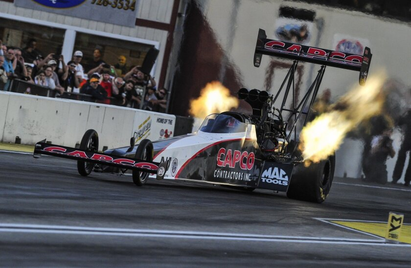 In this photo submitted by the NHRA, Top Fuel racer Steve Torrence powers to the qualifying lead at the NHRA New England Nationals at New England Dragway in Epping, N.H., with a run of 3.710 seconds at 325.92 mph. Torrence has four No. 1 qualifying positions in the first nine races of the NHRA Mell