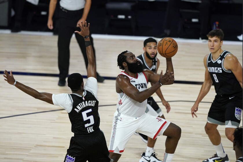 Houston's James Harden puts up a shot past Sacramento on Aug. 9, 2020.