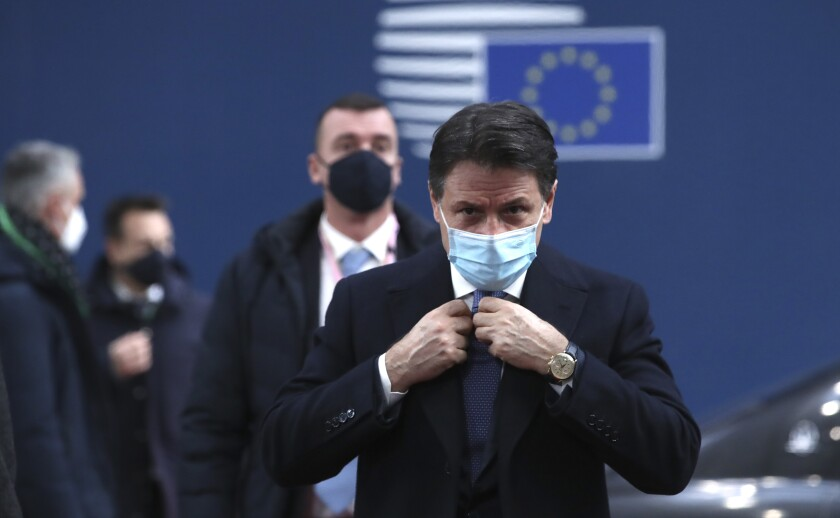 FILE - In this Thursday, Dec. 10, 2020 file photo, Italy's Prime Minister Giuseppe Conte arrives for an EU summit at the European Council building in Brussels. When Giuseppe Conte exited the premier's office, palace employees warmly applauded in him appreciation. But that's hardly likely to be Conte's last hurrah in politics. Just a few hours after the handover-ceremony to transfer power to Mario Draghi, the former European Central Bank chief now tasked with leading Italy in the pandemic, Conte dashed off a thank-you note to citizens that sounded more like an ''arrivederci″ (see you again) then a retreat from the political world he was unexpectedly propelled into in 2018. (Yves Herman, Pool via AP)