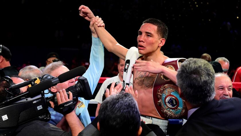 Oscar Valdez celebrates his unanimous 12-round decision over Miguel Marriaga during the WBO Featherweight World Championship bout at StubHub Center on April 22, 2017.
