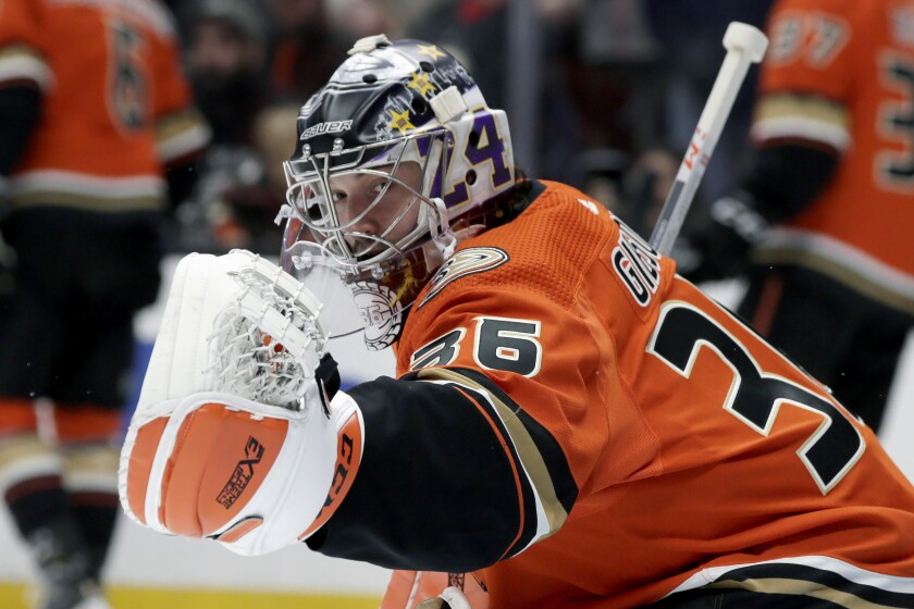Ducks goaltender John Gibson wears a mask paying tribute to Lakers legend Kobe Bryant and the eight others who died in a Calabasas helicopter crash Sunday.