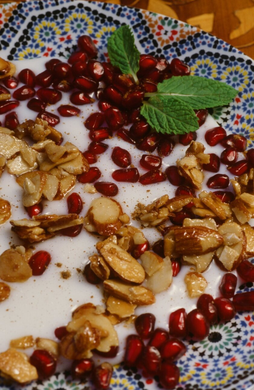 """Orange Blossom Mulhalbiya with Pomegranate Seeds and Honeyed Almonds, a Moroccan recipe in Kitty Morse's latest memoir/cookbook """"Mint Tea and Minarets."""" CREDIT: Owen Morse"""