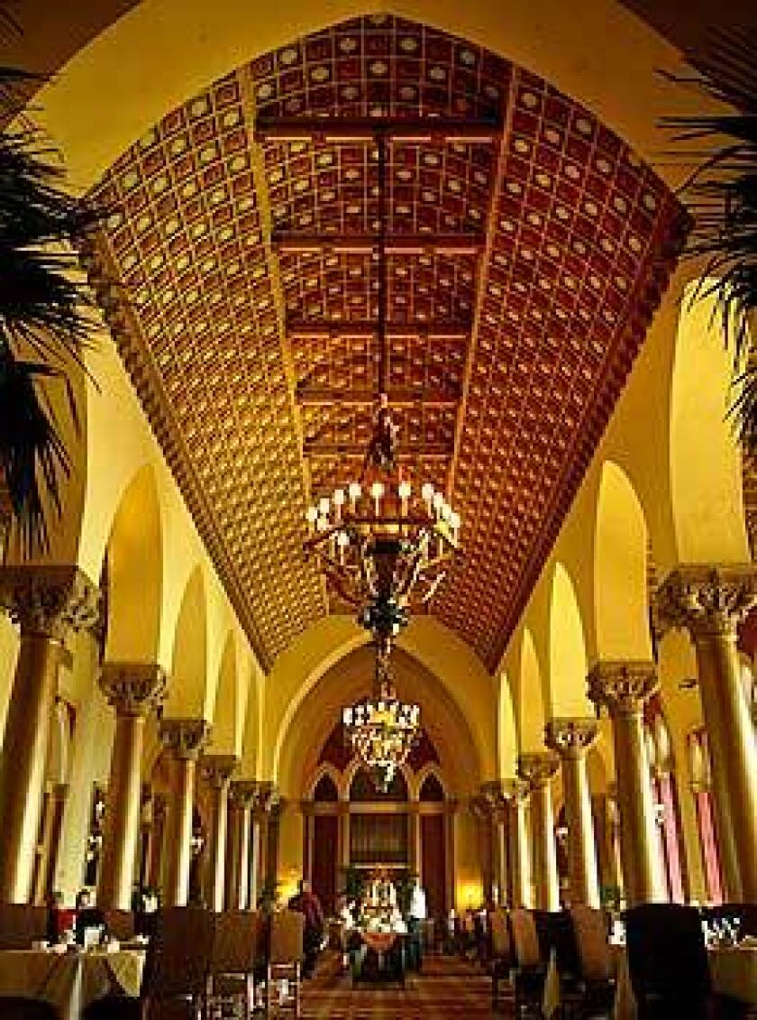 Boca Raton Resort guests enjoy a buffet in the Cathedral room. The Florida resort includes five hotels spread over 356 acres.