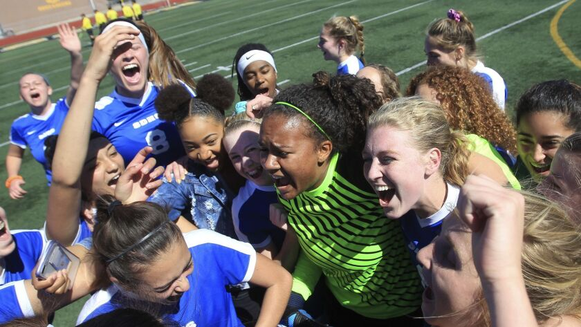 San Diego High School's soccer team celebrates their victory over Serra in the Division III high sch