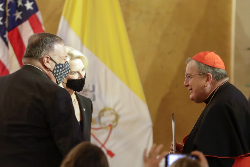 U.S. Secretary of State Mike Pompeo, from left, and ambassador Callista Gingrich greet Cardinal Raymond Burke.