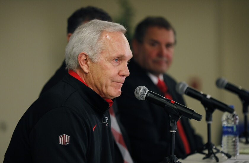 San Diego State University football coach Rocky Long (left) announced his retirement and Brady Hoke (right) was named to replace him by SDSU athletic director J.D. Wicker on Jan. 8.
