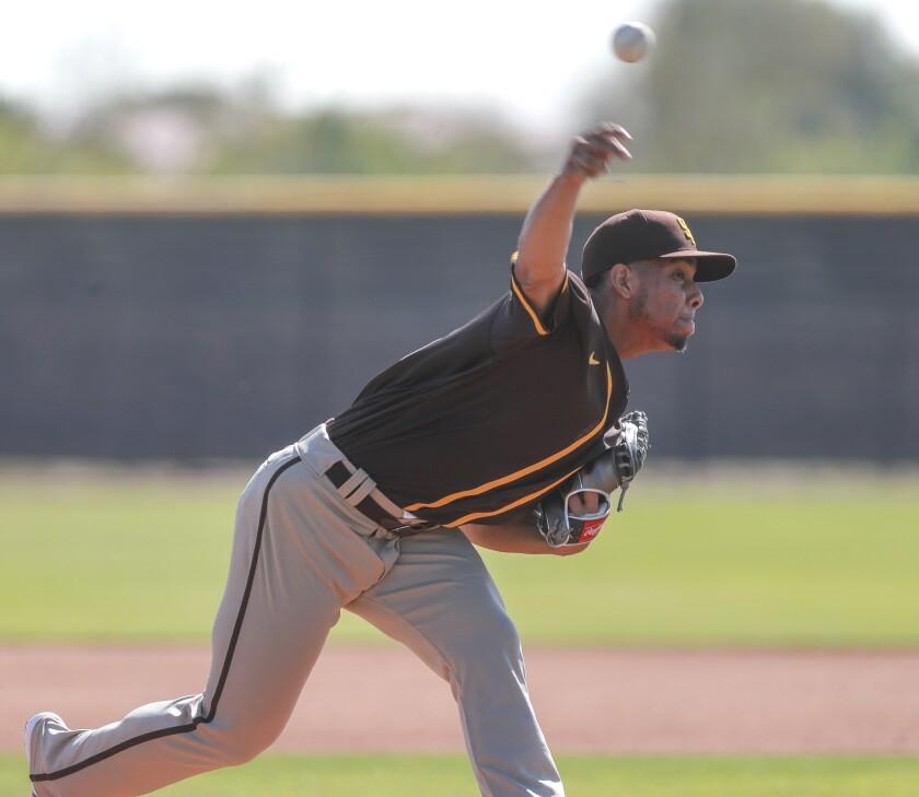 Padres pitcher Luis Patiño throws during Padres spring training