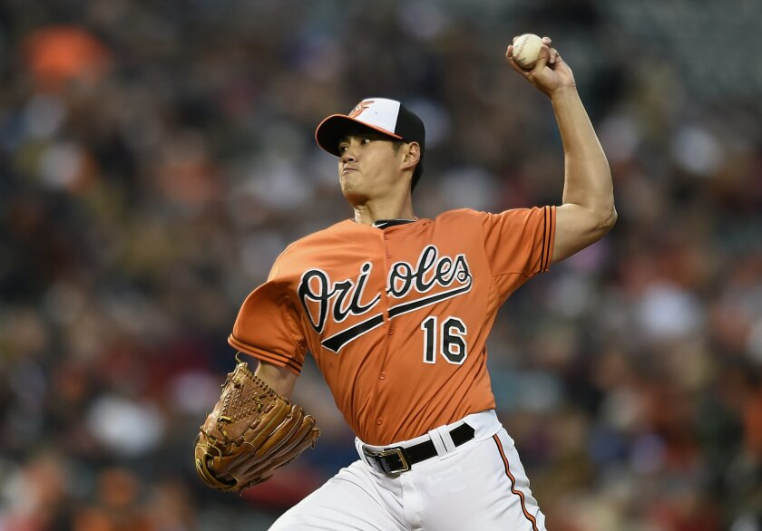 Baltimore Orioles starting pitcher Wei-Yin Chen delivers against the Boston Red Sox in the second inning of a baseball game, Saturday, April 25, 2015, in Baltimore. (AP Photo/Gail Burton)