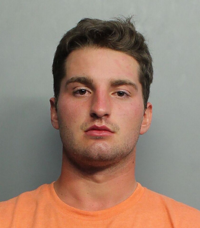 This booking image provided by the Miami-Dade Police Department shows Maxwell Berry, 22, of Norwalk, Ohio, who was arrested Saturday, July 21, 2021, at Miami International Airport and charged with three counts of misdemeanor battery, according to a Miami-Dade police report. Berry is accused of groping two female flight attendants and punching a male flight attendant during a flight from Philadelphia to Miami, officials said. (Miami-Dade Police Department via AP)