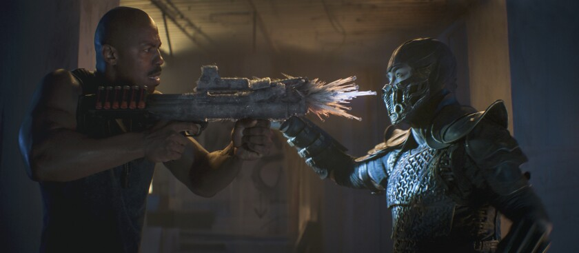 """This image released by Warner Bros. Pictures shows Mehcad Brooks, left, and Joe Taslim in a scene from """"Mortal Kombat."""" (Mark Rogers/Warner Bros. Pictures via AP)"""