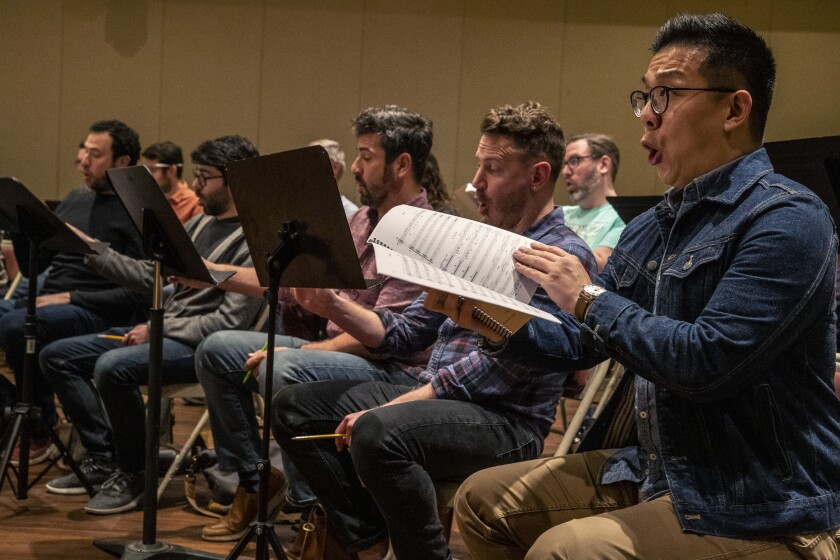 """Ben Lin, right, sings bass with the Los Angeles Master Chorale as the group rehearses """"Sunrise: A Song of Two Humans."""""""