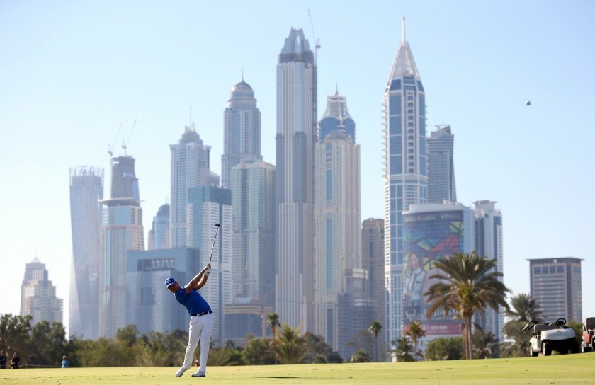 Danny Willett of England plays a shot on the 13th hole during final round of the Dubai Desert Classic golf tournament in Dubai, United Arab Emirates, Sunday, Feb. 7, 2016. (AP Photo/Kamran Jebreili)
