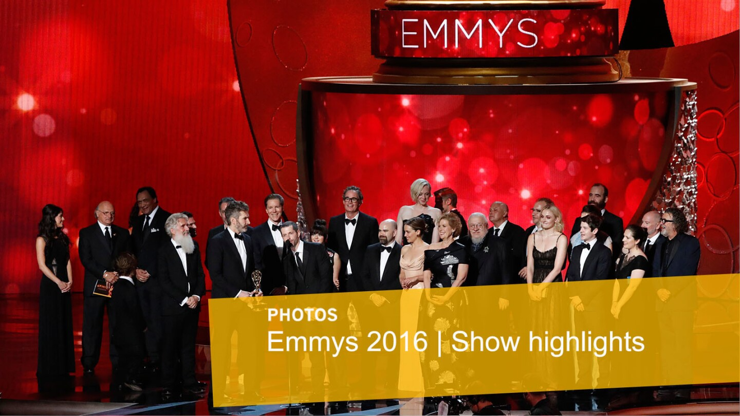 """D.B. Weiss at the microphone and David Benioff, at left of Weiss, accept the Emmy for Drama Series for """"Game of Thrones"""" with the cast and crew."""