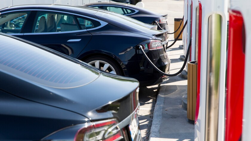 Electric Tesla cars parked at a supercharger facility in Sarpsborg, Norway.