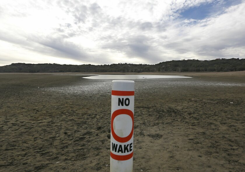 In this photo taken Tuesday, Feb. 4, 2014, a warning buoy sits on the dry, cracked bed of Lake Mendocino near Ukiah, Calif.  Despite recent spot rains The reservoir, located in Mendocino County is currently only about 37 percent full.  California remans in the midst of an historic drought causing G