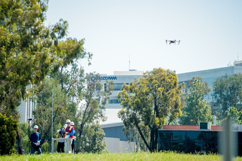 Qualcomm engineers operate a drone at the company's San Diego campus on Tuesday. The company received approval from the Federal Aviation Administration this week to perform outdoor testing.