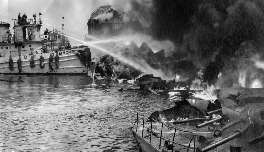 June 22, 1947: Firefighters work to control flames from the wreckage of the tanker S. S. Markay afte