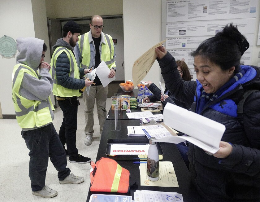 A group of volunteers in Burbank return to the city's community services building after a night of counting the city's homeless population as part of the annual Greater Los Angeles Homeless Count on Tuesday, Jan. 21.