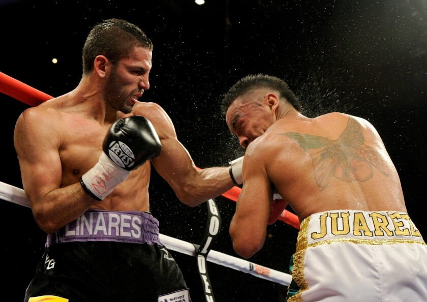 Jorge Linares (L) hits Rocky Juarez in the ninth round of their lightweight fight at the Mandalay Bay Events Center July 31, 2010 in Las Vegas, Nevada. Linares beat Juarez by unanimous decision.