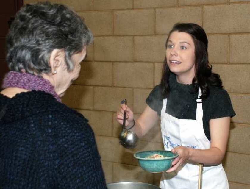 On the Town: Supporters eat soup, assist families in need