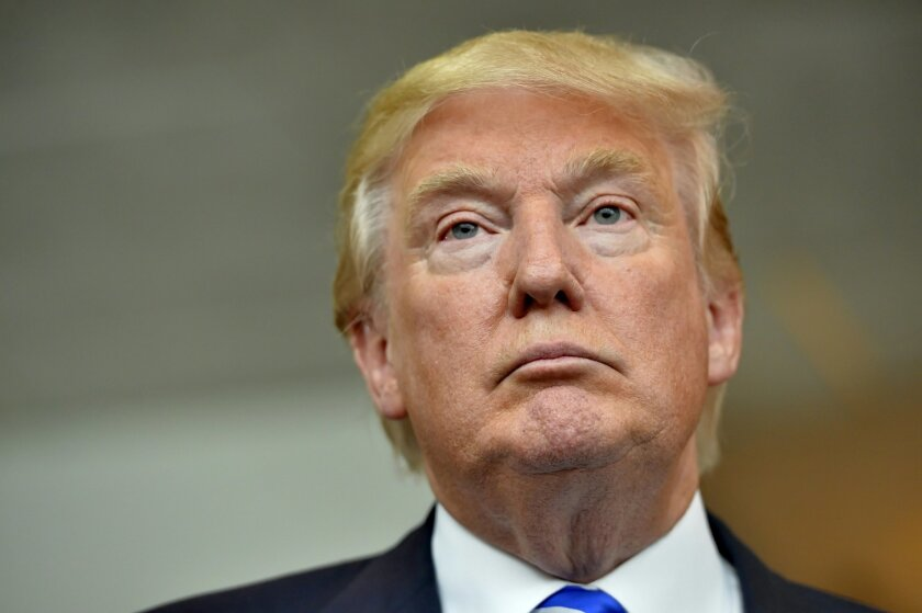 Republican presidential candidate Donald Trump listens during a news conference after speaking at the TD Convention Center, Thursday, Aug. 27, 2015, in Greenville, S.C. (AP Photo/Richard Shiro)