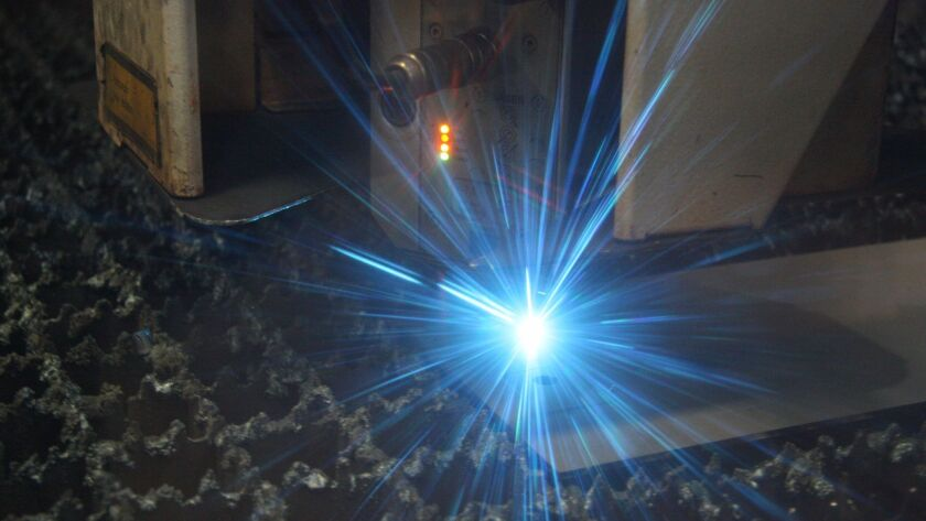 Computer-controlled welders cut the sheet metal to prep for stamping.
