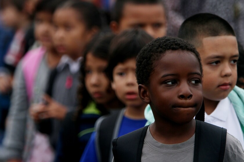 Dillen Gilmore, 6, is first in line in his first grade class, on the first day of school at Fair Elementary School, in North Hollywood, CA August 13, 2013.