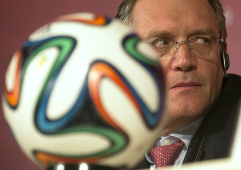FILE - In this Monday, Feb. 16, 2015 file photo FIFA Secretary General Jerome Valcke listens to Russian Sports Minister Vitaly Mutko during a press conference in St.Petersburg, Russia. FIFA says it suspended secretary general Jerome Valcke with immediate effect, Thursday Sept. 17, 2015 hours after