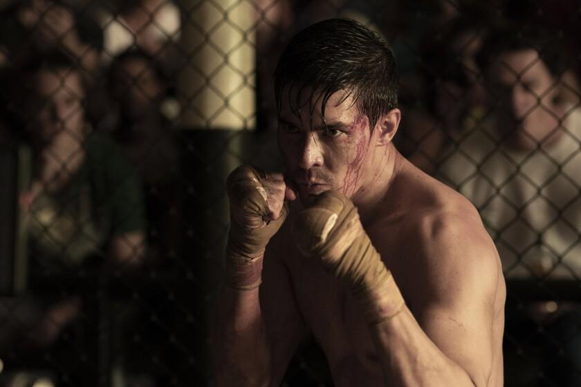 "Lewis Tan in fighter's stance in ""Mortal Kombat."""