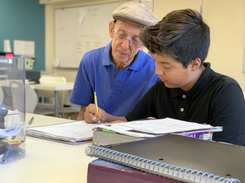 Andy Achterkirchen working with a student.