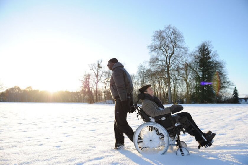 """Francois Cluzet, in wheelchair, and Omar Sy in a scene from """"The Intouchables."""""""
