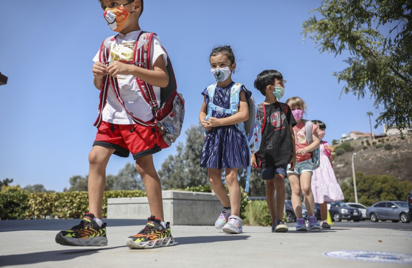 Kindergartners walk to class at Sunset Hills Elementary School in Poway on Oct. 1.
