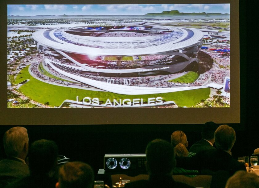 An architectural rendering for a new NFL stadium is projected during a lunch sponsored by the Los Angeles Sports Council downtown Los Angeles Monday, Aug. 17, 2015. The $1.7-billion new NFL football stadium proposed for Carson by the owners of the San Diego Chargers and Oakland Raiders will be loca