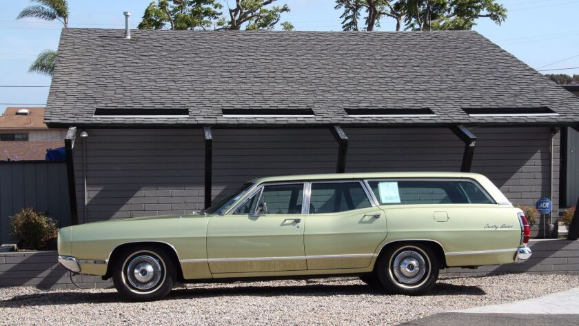 The big 1969 Ford wagon, nicknamed 'Tank,' hosted many family trips, including a monthlong adventure
