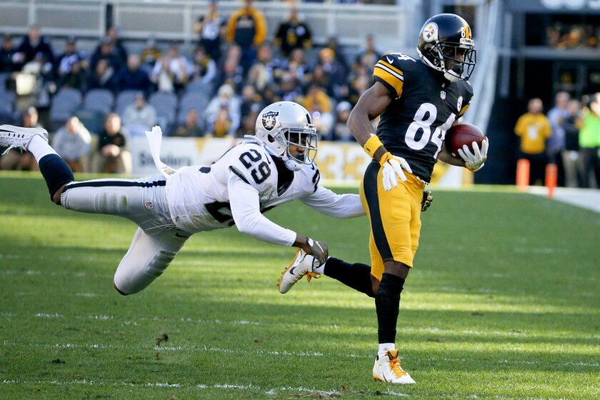 Pittsburgh Steelers wide receiver Antonio Brown (84) makes a catch past Oakland Raiders cornerback David Amerson (29) in the first half of an NFL football game Sunday, Nov. 8, 2015, in Pittsburgh. (AP Photo/Gene J. Puskar)