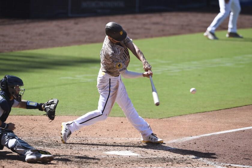 Wil Myers, de los Padres de San Diego, conecta un jonrón de tres carreras