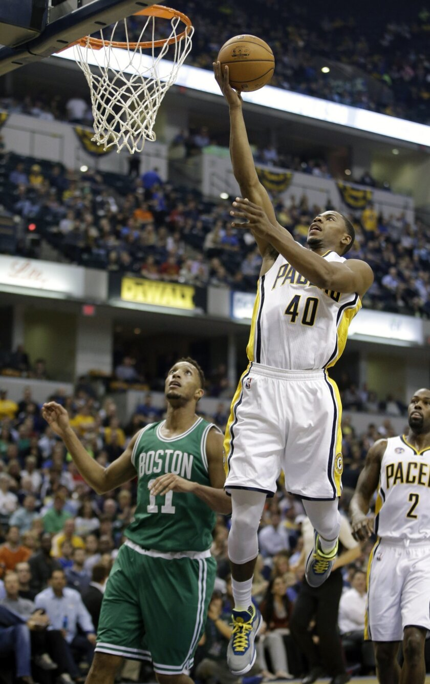 Indiana Pacers' Glenn Robinson III (40) puts up a shot against Boston Celtics' Evan Turner during the first half of an NBA basketball game Wednesday, Nov. 4, 2015, in Indianapolis. (AP Photo/Darron Cummings)