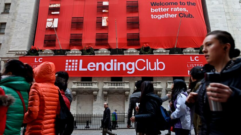 Banners promoting online lender LendingClub hang on the facade of the New York Stock Exchange in 2014.